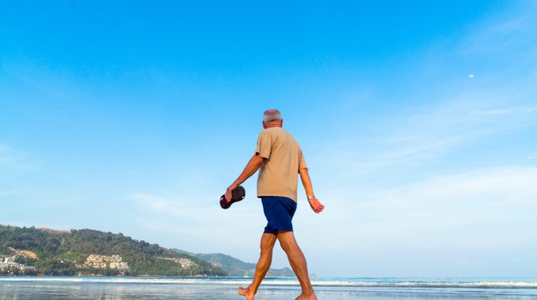 Featured | Senior man walking at the beach | What Is Andropause (Male Menopause)? The Effects of Hormone Deficiency in Men
